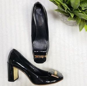 Louis Vuitton patent leather pumps with gold